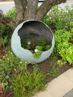 Little and Lewis water feature in Marie's Garden entry--- This is amazing.This is one AWESOME concrete sphere used as a water garden.Spray the inside of your concrete sphere with Rust-Oleum LeakSeal and fill with water for a pretty water feature. Concrete Pots, Concrete Crafts, Cement Planters, Concrete Garden Ornaments, Cement Garden, Garden Crafts, Garden Projects, Diy Projects, Diy Crafts