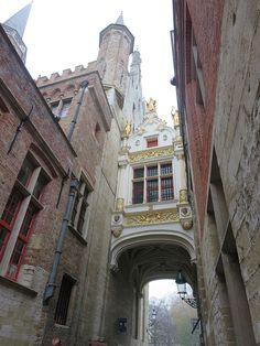 Gilded walkway between buildings in Bruges, Belgium