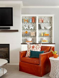 Jazz up a built-in with wallpaper, fabric, or wrapping paper remnants! More ideas: http://www.bhg.com/decorating/budget-decorating/cheap/decorate-with-what-you-have/#page=9