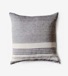 Unbleached organic cotton, natural plant dyes and skilled handiwork are the primary components that go into this striped pillow cover. Cotton fibers are colored and spun into fine thread before weaving, one row at a time, on traditional looms. Off white and grey stripes are accented with sections of a thinly striped and dotted pattern, the cover designed to reverse and show on both sides.