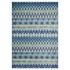 Showcasing ikat-inspired stripes, this eye-catching rug anchors your dining set or living room seating group in chic style.     P...