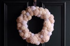 Adorable pom-pom wreath...Audrey would love this...maybe in the fall
