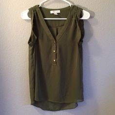 Forever 21 Tank Army green and slightly sheer. It has a slight high-low cut. It's NWOT, but one of the stitches keeping the shirt cuff down is missing. It was purchased like that. Adding a stitch or two is easy enough and would fix the issue! Forever 21 Tops Tank Tops