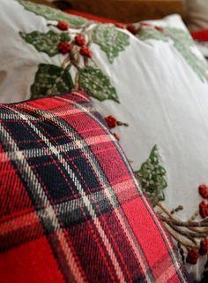 A single red tartan pillow adds immediate coziness.