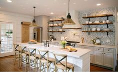 No upper cabinets just shelving.  Install a lot of lower cabinets with drawers…