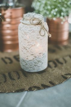 lace wrapped jars // photo by Studio 29 // view more: http://ruffledblog.com/wisconsin-pop-up-dinner-wedding