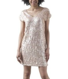 Dress covered in mother-of-pearl sequins to create  a soft, glinting effect.  Irresistibly stylish. Another option for an upcoming (very special) day :)