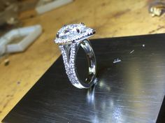 Pear shape platinum and diamond ring