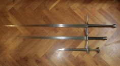 My hema/reenactment weapons. How to tell a good and bad sword? Put them close together, the difference between those two longswords is just clearly visible.