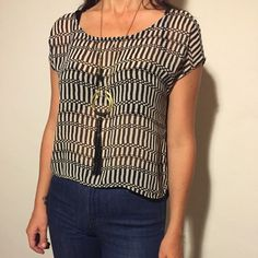 Black & white print blouse. Black & white striped print blouse. Shorter & slightly sheer in front, longer & opaque in back. Soft and light like a feather, can be dressed up with black jeans & heels or down with blue denim. Tops Blouses