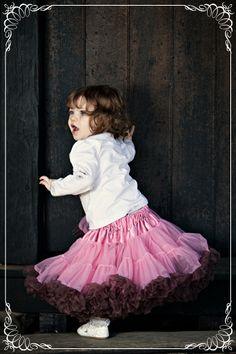 petticoats; she looks so cute and like she is having a blast!