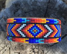 Items similar to Beaded Geometric Design Bracelet, in Reds, Orange, Mustard, Blues and Black on a Cream Background. on Etsy Native Beading Patterns, Beaded Jewelry Patterns, Beading Jewelry, Loom Bracelet Patterns, Bead Loom Patterns, Beaded Cuff Bracelet, Bead Loom Bracelets, Collar Indio, Bracelets Design
