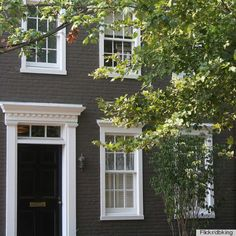 dark gray exterior paint color with black door...also love that you could easily change the appearance of your home with this solid brick.