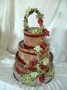 If these were Jack Daniels barrels then Tom might be down for this at our wedding lol - Vineyard Grapes and Barrels Wedding Cake