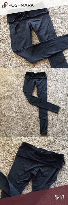 Lululemon heather grey leggings Dark heather grey and black Lululemon leggings with black fold over band. In great condition! The last photo shows, these were altered by the previous owner. I am 5'7 and they are still long enough for me-if anything maybe too long. lululemon athletica Pants Leggings