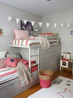IKEA stuva loft / bunk bed hack with storage. This has 2nd bed added along same wall. Great for 2 kids sharing room.