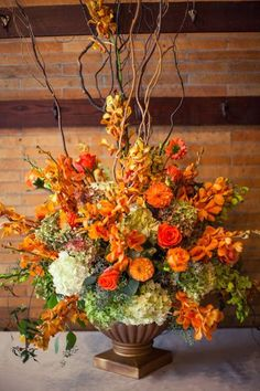 Thanksgiving Floral Centerpieces Three Awesome Thanksgiving Flowers and Floral Arrangements Thanksgiving Floral Centerpieces. Thanksgiving flowers are a wonderful way to brighten up your dining roo… Flower Arrangement Designs, Fall Flower Arrangements, Floral Centerpieces, Wedding Centerpieces, Candle Arrangements, Wedding Decorations, Church Flowers, Fall Flowers, Orange Flowers