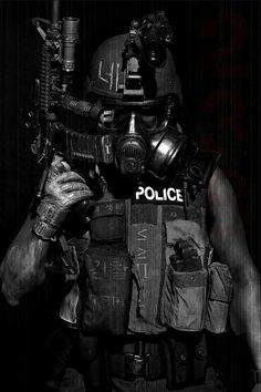 Riot, future soldier, cyberpunk, future police, mask, armor, gun, futuristic, weapon, dark, industrial, black clothing, military by FuturisticNews.com