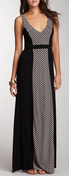The center front of this dress has stripes that are in a chevron pattern, which directs the eyes down and lengthens. The stripes add interest and details, and the black sides are very slimming. S.H.E. Striped Panel Maxi Dress