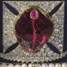 An incredibly large photograph of The Black Prince's Ruby in the front arch of Britain's Imperial State Crown. One can see right through the stone! The Photograph is about 10 inches high.