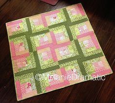 Log Cabin - Layed out by Melanie Dramatic, via Flickr  (I love the way she quilted this)