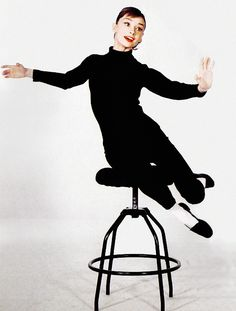 Audrey Hepburn - Funny Face promotional photo, 1957. She isn't always so serious! She's gorgeous having fun!!!!