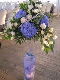 Flower arrangements in blue, perfect for the venue by the sea for a gorgeous event in Greece. See more here: http://www.StyleConcept.gr/en