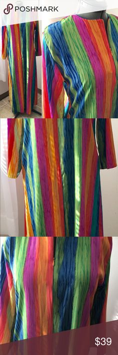 """RARE VTG Rainbow Striped Sz S Ruth Norman Caftan This is a RARE vintage rainbow stripe caftan by Ruth Norman New York for Neiman Marcus. It is full-length, A Line, pullover style, with long sleeves, a 1/2 front zip and POCKETS! Unlined with a neck facing for shape. The silky woven polyester has a matte finish and feels great against the skin. Perfect for lounging or entertaining. In MINT vintage condition! You won't be disappointed!  Label Size: S Bust: 21"""" armpit to armpit Sleeve Length…"""