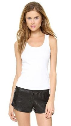 Home :: Tanks :: Three Dots Flat Knit Tank - White A simple jersey tank from Three Dots, finished with tonal overlock stitching. Fabric: Jersey. 100% cotton. Wash cold. Made in the USA. MEASUREMENTS Length: 23in / 58.5cm, from shoulder. Available sizes: L,M,S Price: €36.35 Buy More information