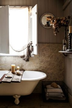 A bathtub with a window- always a nice view