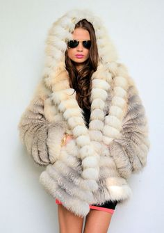 Never been a fan of fur .. Until right now .. Gorgeous Coat!!