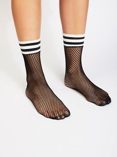 Riot Sport Fishnet Sock   Classic fishnet socks featuring an athletic-inspired stripe detailing at the top.