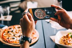 Taking pictures of a pizza by sakesirivip  IFTTT 500px meal camera communication food food photography hand leisure activity lifestyles lunch