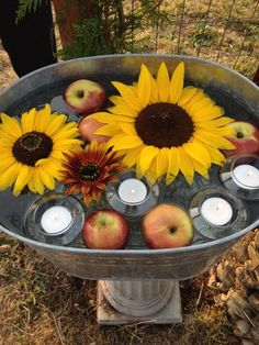 Anything in a galvanized tub looks instantly charming, but we're especially smitten with sunflower-and-apple combo. Add floating tea lights for a finishing touch.  Get the tutorial at Valley & Co. Lifestyle »   - HouseBeautiful.com