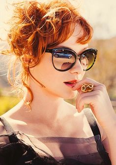 """Christina Hendricks from """"Mad Men"""" rocking the cat-eye style with big black frames and mirrored lenses. Christina Hendricks, Beautiful Christina, Beautiful Redhead, Mad Men, Cristina Hendrix, Pretty People, Beautiful People, Beautiful Ladies, Foto Portrait"""