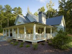 I want a full wrap around porch. Farmhouse Style Homes | Southern farmhouse-style exterior | Future House