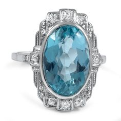 The Savanna Ring This dazzling Art Deco ring showcases a dramatic and striking oval-shaped aquamarine. The ornate setting features eight single cut diamond accents in a captivating composition that emphasizes the nearly six carat gem (approx. 0.23 total carat weight).