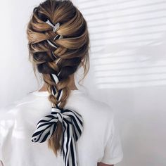 Woman with long bronde hair styled into a French braid updo with a scarf weaved . - Woman with long bronde hair styled into a French braid updo with a scarf weaved through it, wearing - Box Braids Hairstyles, African Hairstyles, Updo Hairstyle, Prom Hairstyles, Hairstyles With Scarves, Bandana Hairstyles For Long Hair, Quinceanera Hairstyles, Hairstyles Videos, Hairstyle Tutorials