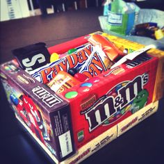 Easter basket made out of candy boxes! Very creative.