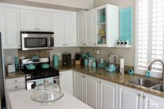 Fresh, Bright & Fun Aqua Accented White Kitchen Makeover by Breezy Design at foxhollowcottage.com