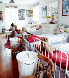 white trashcans as hampers- love the whole room