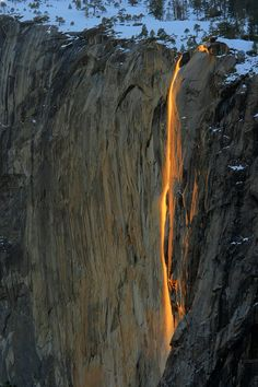 """For over 100 years folks in Glacier Point used to dump embers from fires into Yosemite Falls to create the """"firefalls"""". That tradition has long since been stopped by the Yosemite National Park Rangers; but today, the firefalls are created by nature. During the final two weeks of February, the firefalls can be seen from a distance if the sun is hitting Yosemite Falls at just the right angle. How spectacular is that!"""