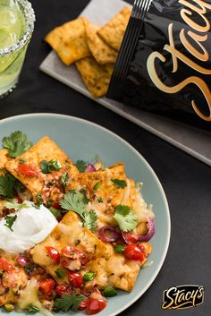 Spice up your Cinco de Mayo with Pitaquiles from Stacy's® and Chef Douglas Keane! A delicious twist on the classic chiliquiles recipe, Pitaquiles are made with Stacy's® Fire Roasted Jalapeno Pita Chips, salsa, cilantro, cheddar cheese and more. This simple dish can be made and enjoyed in under 15 minutes– a perfect anytime recipe for the summer season!