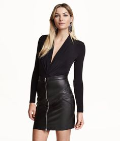 Long-sleeved body in jersey with a slight sheen, with a draped wraparound front and press-studs at the crotch.