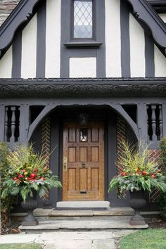 painted front door on brick tudor Tudor House Exterior, House Paint Exterior, Exterior Design, Bungalow, D House, House Front, Toll House, Christmas Door Decorations, Christmas Lights