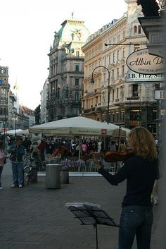 Street Musician - Vienna, Austria. In corner, you see the sign for Albin Denk - one of my favorite stores off the Graben