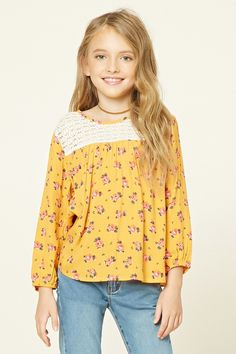 Forever 21 Girls - A woven peasant top featuring an allover floral print, a crochet front yolk, long sleeves with elasticized cuffs, a back button closure, and a flowy silhouette.