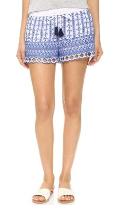 Embroidery adds bohemian flair to these lightweight Love Sam shorts. Tassels trim the drawstring waist.