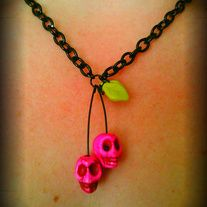 DIY A very simple and adorable set of cherries made out of hot pink Howlite skull beads with glass leaf accents.