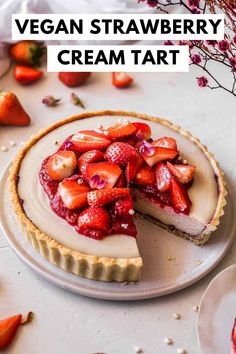 Vegan strawberries and cream tart with a cookie base, creamy filling, strawberry jam, compote and fresh berries!